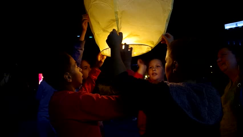 GABROVO, BULGARIA - SEPT 14, 2013: Traditional release of flying lanterns in the evening before the start of the school year. Many children, teenagers and adults took part.
