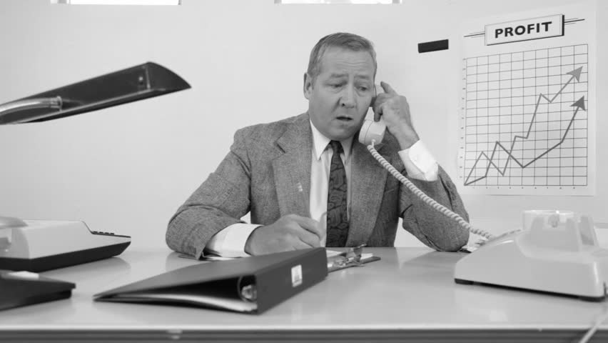 Businessman working at desk. Vintage black and white.