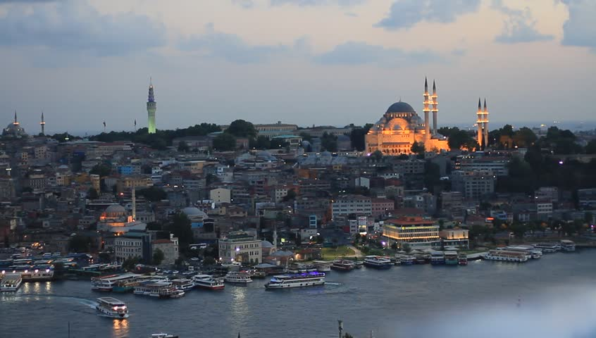 Old Istanbul in prayer time. Looking over Golden Horn to Suleymaniye Mosque, in the distance famous landmarks such as Beyazit Tower and Eminonu motor port.