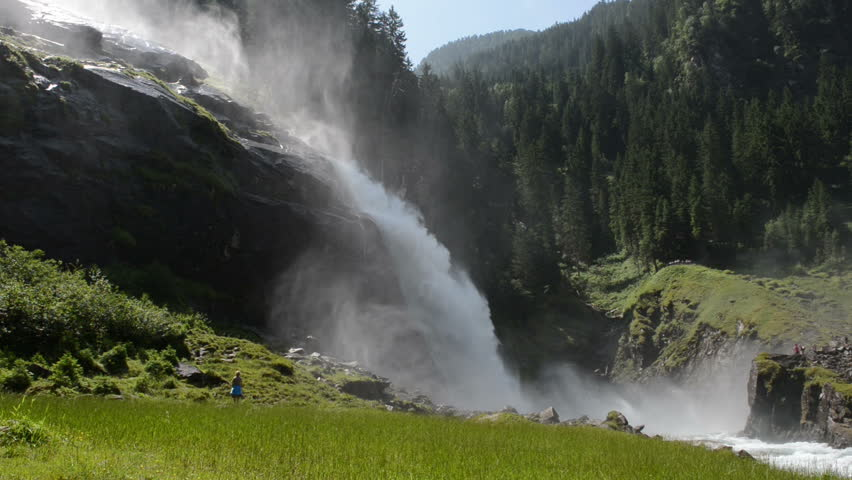 KRIMML, AUSTRA – JULY 17: People visiting the Krimml Waterfalls as part of High Tauern National Park. The Krimml Waterfalls has a total height of 380 meters. Located at Krimml on July 17, 2013