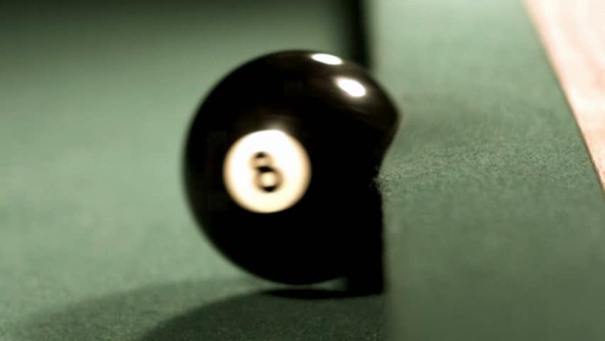 Pool ball hitting bumber, slow motion