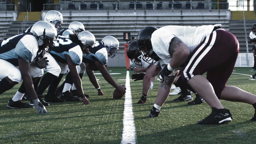 A football player runs through the line and avoids tackles | Shutterstock HD Video #4706336