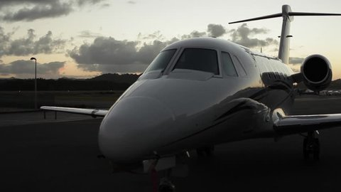Left to right pan shot of a grounded Cessna Citation VII at dusk. Shot on a Canon 5D MK II with a 70-200mm f2.8 zoom lens.