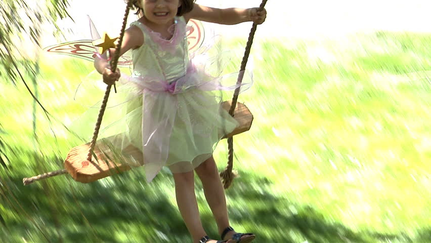 Young girl swinging