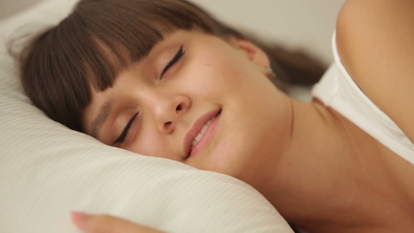 Beautiful girl sleeping in bed waking up and smiling at camera | Shutterstock HD Video #4733717