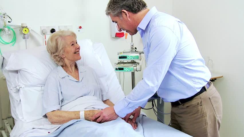 African American Nurse Cares For A Bedridden Elderly Female Patient Stock Footage -7947