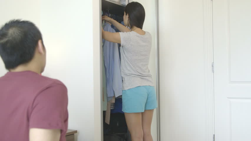 MS Young woman showing dress to man in bedroom | Shutterstock HD Video #4782071