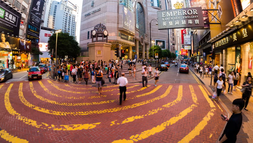 HONG KONG - 13 SEPT: Timelapse view of people at a crossing on the streets of Causway Bay in Hong Kong. Hong Kong is a major financial hub in the Asia region on 13 September 2013 in Hong Kong, China
