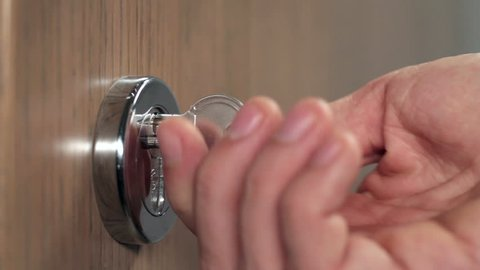 Locking the door in close up. High definition video.