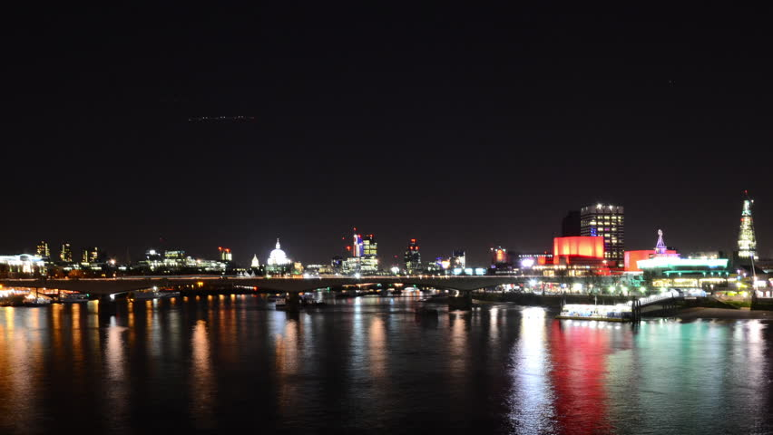 Time Lapse of River Thames at night, in London, United Kingdom.