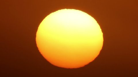 Close-up of the sun, just after sunrise. Real time footage.