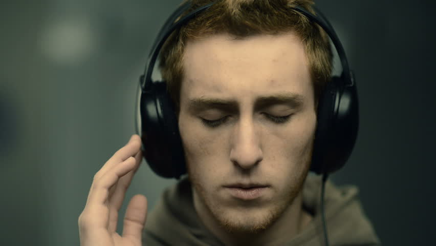 Young Man With Headphones Listening Stock Footage Video 100 Royalty Free 4826987 Shutterstock