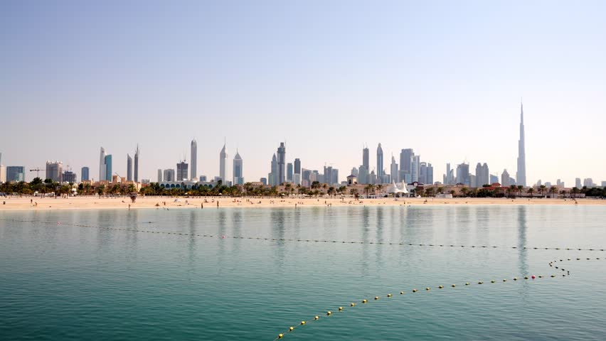Skyline of Dubai with Jumeirah Beach in foreground. United Arab Emirates