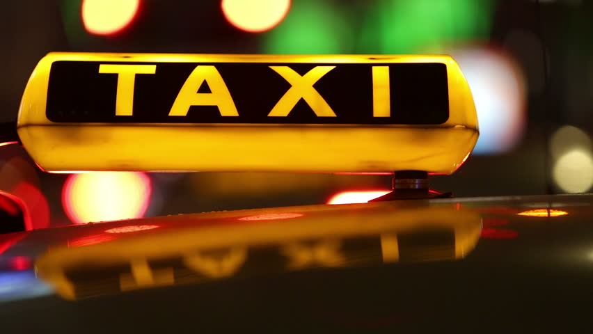 Taxi (Cab) driving with motion blur and city lights in 1080p FullHD