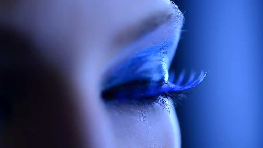 Beauty Woman Eye Makeup. Beautiful Holiday Make-up for Blue Eyes. False Blue Eyelashes. Night Party