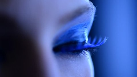 Beauty Woman Eye Makeup. Beautiful Holiday Make-up for Blue Eyes. False Blue Eyelashes. Night Party