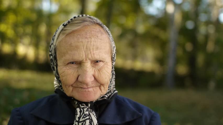 old person outdoors portrait closeup