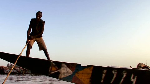MALI-CIRCA 2012-POV of a boat being rowed on the Niger River in Mali, Africa.