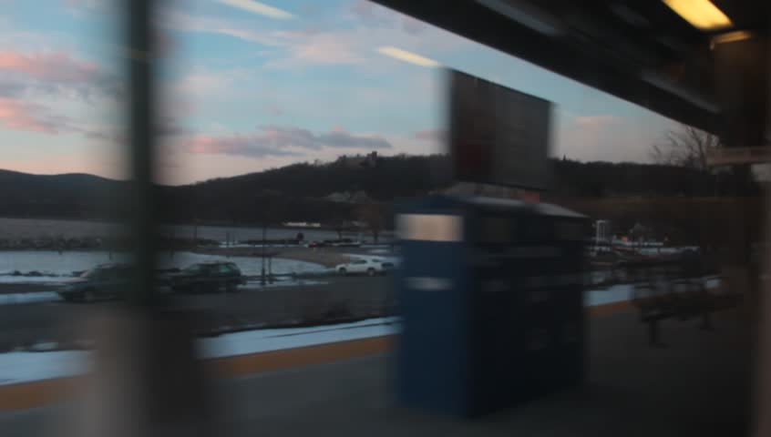 Train POV along Hudson River at sunset pulling out of Station | Shutterstock HD Video #4897637