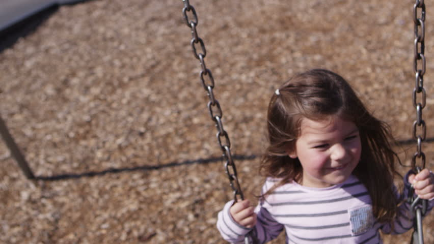 Little girl on swing set