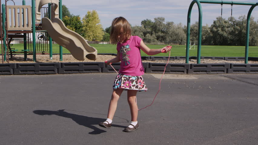 c76cbb53081a Little Girl Jumping Rope Stock Footage Video (100% Royalty-free ...