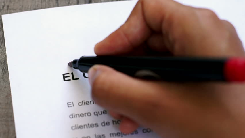 Circling Customer is king with a pen (In Spanish) | Shutterstock HD Video #4907657