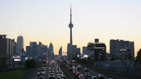 TORONTO,CANADA-OCTOBER 9: CN Tower at dawn as seen from the QEW. One of the highest structures in the world and a tourist landmark as shown on October 9, 2013 in Toronto, Canada.