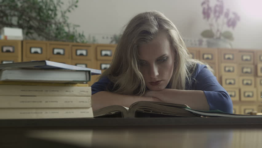 Girl student reading books in the library | Shutterstock HD Video #4917437