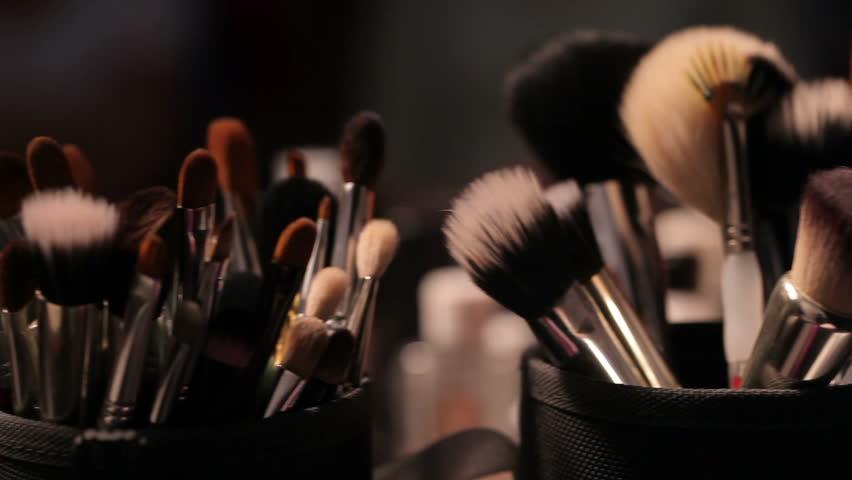 Brush set for make-up on table (dolly shot)
