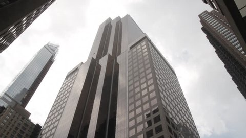 New York, NY - July 2013 - Manhattan exterior office building midtown. tilt up from truck stuck in traffic.