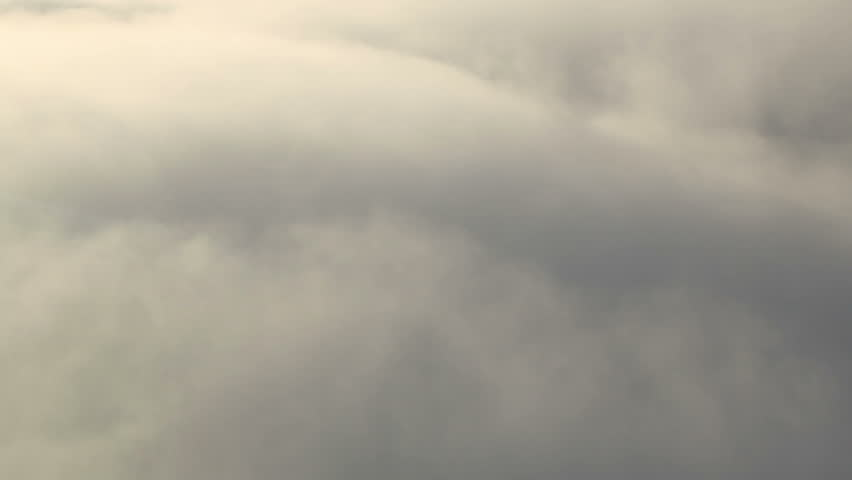 Side view shot of flying through and then above clouds | Shutterstock HD Video #4941824