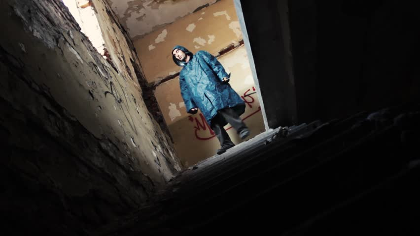 Horror scene, masked killer with machete chasing a girl in abandoned building through the hallways.The girl running down the stairs,murderer with hod go for her. | Shutterstock HD Video #4949414