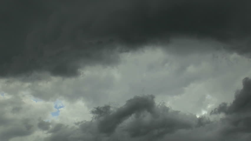 Time Lapse, Fast moving, dark, ghostly monsoon storm clouds circle, engulf sky, dissipate. 1080p