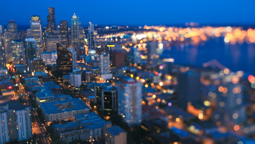 Seattle cityscape time lapse at night using a tilt shift lens with vertical center in focus and both sides out of focus.