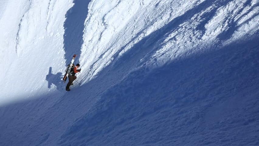 Clip of mountain climber climbing up snow face of Mt Hood. | Shutterstock HD Video #4973687