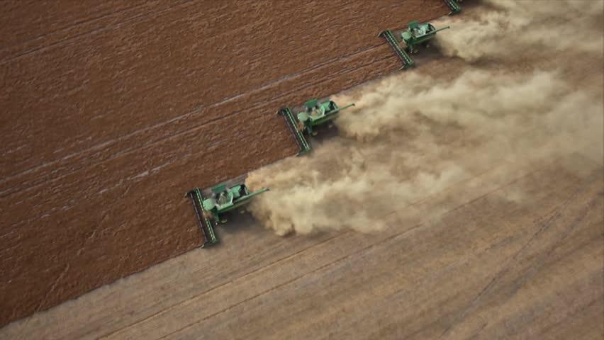 Four combines harvesting lentil field on the Saskatchewan Prairie aerial view | Shutterstock HD Video #4988255
