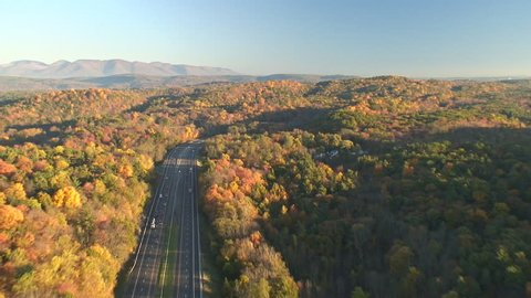 New York state I87 interstate thruway, aerial following shot with cars and trucks. Aerials around the Catskills and upstate NY Hudson Valley.