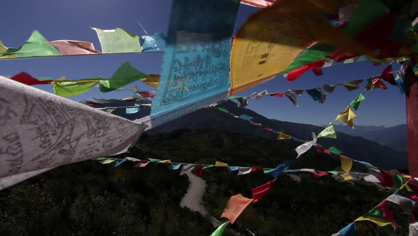 YUNNAN -Oct 13: Prayer flags sway in the wind near the Meili Snow Mountain in Deqin County, Yunnan Province, China | Shutterstock HD Video #5016677
