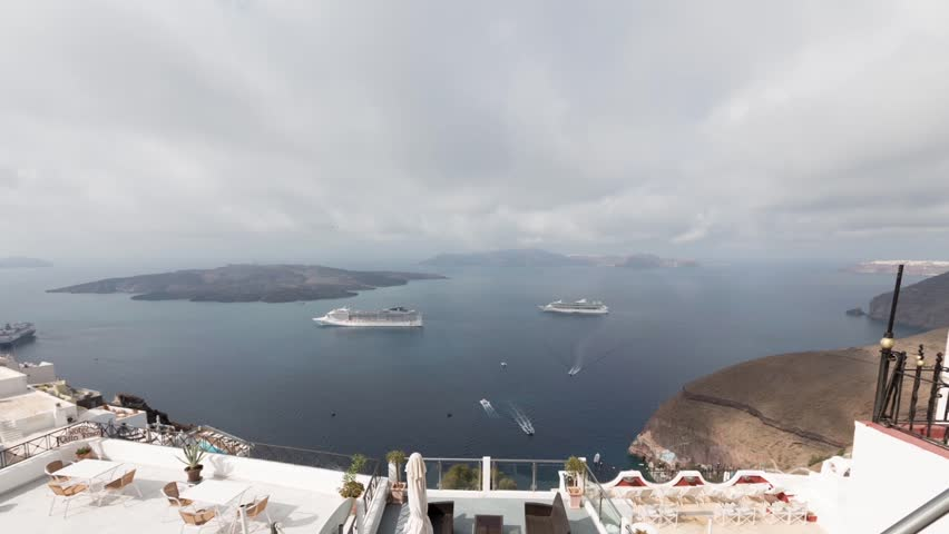 Time-lapse of clouds and movement of ships, the bay of Santorini, Greece