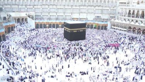 MAKKAH, SAUDI ARABIA - CIRCA FEB 2013: Muslim pilgrims circumambulate the Kaaba at Masjidil Haram circa June 2013 in Makkah, S.Arabia. Makkah is the holiest and most visited mosque for all Muslims.