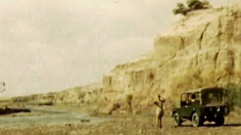 ADEN, CIRCA 1960: Aden Protectorate British Land Rover desert vintage HD. British Aden Protectorate in southern Arabia. One of a kind private owned vintage and historic 8mm film. Republic of Yemen.