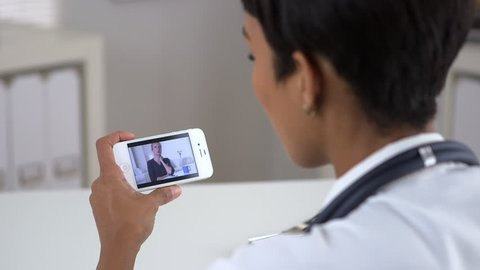 Senior patient video chatting with doctor on iphone