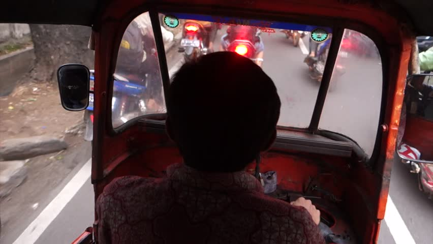 JAKARTA, INDONESIA-NOV 14: A typical traffic jams from a passanger eye view  near Tanah Abang, Jakarta, Indonesia, 14th of November 2013. | Shutterstock HD Video #5069687