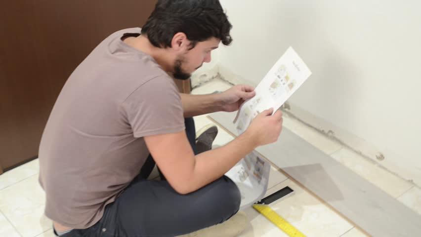 young man doing home repair