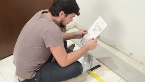 young man doing home repair