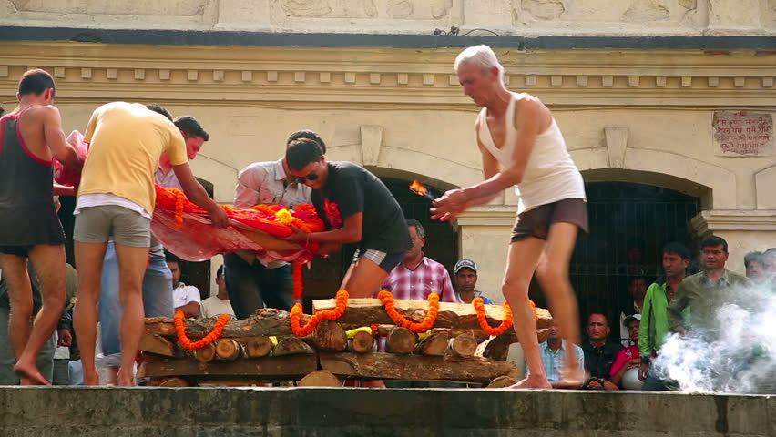 KATHMANDU, NEPAL - JUNE 2013: death corpse burning in fire, cremation ceremony at pashupatinath temple,