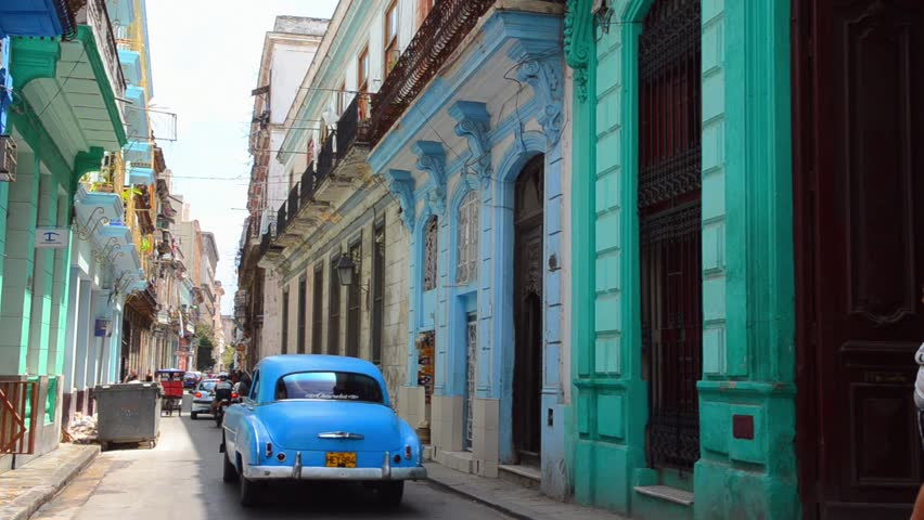 Havana, Cuba - 8/14/13 - colorful downtown pastel buildings near the Capital homes and center city