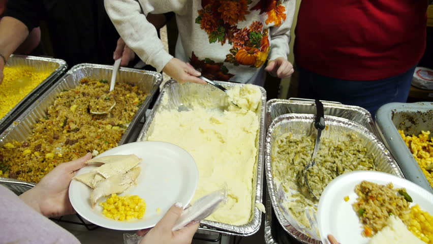 Food being served at a soup kitchen on Thanksgiving.