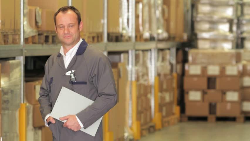 Warehouseman - logistic manager - controls goods. | Shutterstock HD Video #5134967