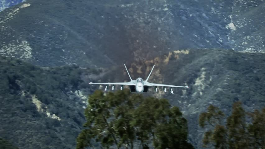 Fighter jet f-18 Airplane flying aggressively toward camera